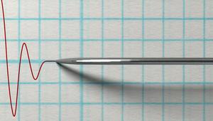 Die Nadel eines Lügendetektors schlägt aus.