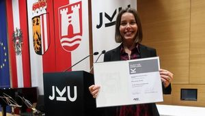 Picture of Medina Hamidovic holding a certificate